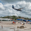 PRINCESS JULIANA AIRPORT, ST MAARTEN - APRIL 19: Airplane lands - Stock Photo