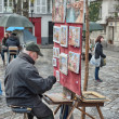 PARIS - DEC 2: Tourists enjoy Montmartre narrow streets, December - Stock Photo