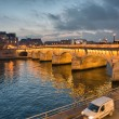 Stock Photo: Paris. Beautiful view of Napoleon Bridge at sunset
