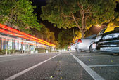 Port Douglas, Australia. Car light trails on Macrossant Road — Stock Photo