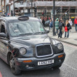 LONDON - SEP 29 : TX1, London Taxi, also called hackney carriage - Stock Photo