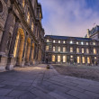 The Louvre, Paris. Beautifully illuminated buildings, exterior v - Stock Photo