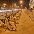 PARIS - DEC 1: Parked rented bycicles in the city streets, Decem - Stock Photo