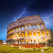 Dramatic sky above Colosseum in Rome. Night view of Flavian Amph - Stock Photo