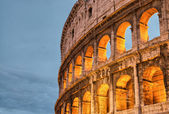 Rome, Italy. Wonderful sunset colors shining on Ancient Colosseu — Stock Photo