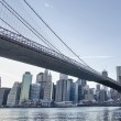 New York. Beautiful Brooklyn Bridge view from East River at suns — Stock Photo #24562039