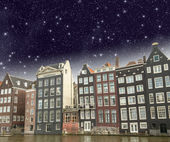 Amsterdam. Beautiful view of classic buildings with night sky — Stock Photo