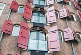 Amsterdam, Netherlands. Facade of a traditional house with beaut — Stock Photo