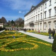 Famous Mirabell Gardens with Fortress Hohensalzburg in the backg — Stock Photo
