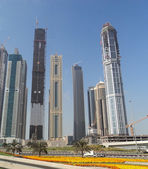 Dubai. Street view of tall buildings and skyscrapers — Stock Photo