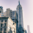 Bottom Up view of New York City Buildings - Stock Photo