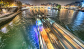 Paris. Beautiful city landscape at night along Seine River — Stockfoto