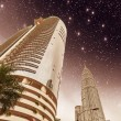 Stars above Kuala Lumpur and its Skyscrapers - Stock Photo