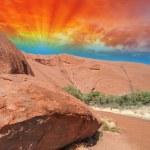Beautiful rocks of Australian Outback against colourful sky — Stock Photo #25348485