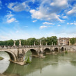Rome, Italy. Beautiful view of Tiber river with famous Bridge — Stock Photo