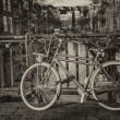 Bicycles lining a bridge over the canals of Amsterdam, Netherlan — Stock Photo