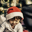 Baby with Christmas Hat playing indoor — Stock Photo