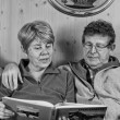 Stock Photo: Senior Couple reading Book, Italy