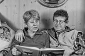 Senior Couple reading a Book, Italy — Stock Photo