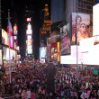 Stock Photo: NEW YORK CITY - JUN 8: Tourists enjoy Times Square at night, Jun