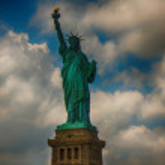 Wonderful upward view of Statue of Liberty, symbol of New York City — Stock Photo #27438447