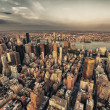 Manhattan. Beautiful aerial view of Midtown skyscrapers from the Empire State Building at summer sunset. — Stock Photo #27681653