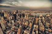 Manhattan. Beautiful aerial view of Midtown skyscrapers from the Empire State Building at summer sunset. — Stock Photo