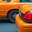 Stock Photo: Row of Yellow Cabs awaiting traffic light green signal
