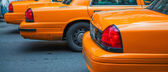 Row of Yellow Cabs awaiting the traffic light green signal — Stock Photo