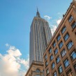 NEW YORK CITY - JUN 12: The Empire State Building high in the su — Stock Photo #29016175