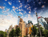 Buildings and trees of Columbus Circle on a summer day - New Yor — Stock Photo