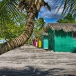 Caribbean Beach with quintessential colorful homes — Stock Photo #29259535