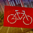 Giant red bike sign in the heart of Amsterdam  — Stock Photo