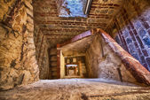 Ancient building interior with spiral staircase — Stock Photo