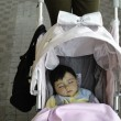 Baby Sleeping in her Pram — Stock Photo