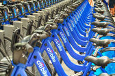 NEW YORK - JUN 9: Bicycles are shown docked at a Citibike sharing kiosk — Stock Photo