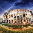 Dramatic sky above Colosseum in Rome. Night view of Flavian Amphiteatre — Stock Photo