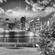 Stock Photo: Manhattan skyline at night as seen from Brooklyn Bridge Park - I