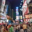 NEW YORK CITY - AUG 25: Tourists walk in the city lights of Time — Stok fotoğraf