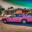 KEY WEST, FLORIDA - JAN 7: Pink taxi speeds up on city streets, — Stock Photo