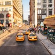 Stock Photo: NEW YORK - MAY 14: Yellow cabs speed up in city, May 14, 201