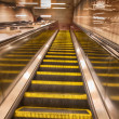 Moving escalators, blurred picture — Stock Photo