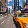 Stock Photo: NEW YORK - MAY 14: Yellow cabs speed up in city