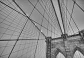 The Brooklyn Bridge at sunset. Upward view of Pylon and cables — Stock Photo