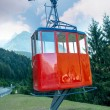 Red Cable Car on a mountain landscape — Stock Photo #31189237