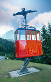 Red Cable Car on a mountain landscape — Stock Photo