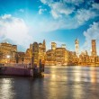 Manhattan skyline with East river reflections at night — Stock Photo