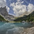 Stock Photo: Wonderful mountain lake azure color with vegetation and peaks