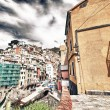 Stock Photo: Beautiful quaint village of Riomaggiore, Cinque Terre - Colorful