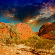 Beautiful rocks of Australian Outback against colourful sky — Stock Photo #31826721